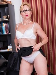 Badd Gramma Is In Her Office Finishing Work, And Strips Off Her Suit And Lingerie. She Touches Her Hairy Pits And Then Her Hairy Bush. She Models Her