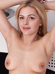 Ayda Is In Her Kitchen Wearing Her Jeans And Is Horny. She Strips Nude And Shows Off Her 34b Breasts And Nice Hairy Bush. She Uses Her Fingers Across