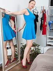 Solene Sol Is Wearing A New Blue Dress And Showing Off Her White Panties Underneath. She Strips Naked And Relaxes On Her Bed Nearby. She Finds Her Blu